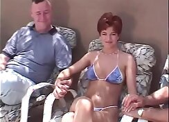 redhead is with two men and she is using them in a threesome